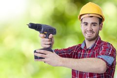 Builder with the drill Royalty Free Stock Photo