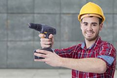 Builder with the drill Stock Image