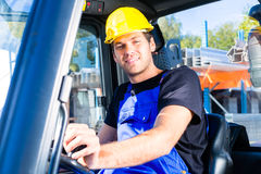 Builder driving site pallet transporter or lift fork truck Royalty Free Stock Photo