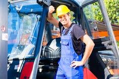 Builder driving site pallet transporter or lift fork truck Stock Photography
