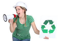 Builder encouraging people to recycle Royalty Free Stock Photo