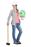 Builder with energy rating sign. Builder with an energy rating sign Stock Photos