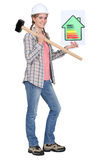 Builder with energy rating sign. Woman with energy rating sign royalty free stock images