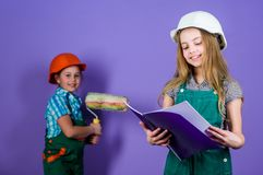 Builder engineer architect. Kid worker in hard hat. Child development. Tools to improve yourself. Repair. small girls. Repairing together in workshop. Future stock images