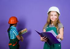 Builder engineer architect. Kid worker in hard hat. Future profession. Tools to improve yourself. Repair. Child care. Development. small girls repairing royalty free stock photo