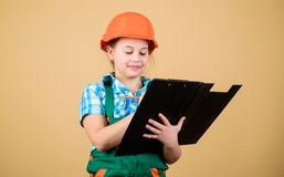 Builder engineer architect. Kid worker in hard hat. small girl repairing in workshop. Safety expert. Future profession. Child care development. Foreman stock photos