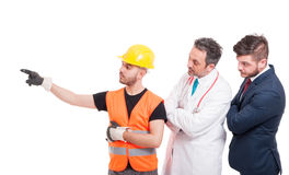 Builder or engineer indicate something Stock Photos