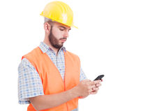 Builder or engineer texting or sending sms Royalty Free Stock Photo