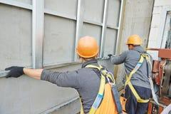 Builder at facade construction work Royalty Free Stock Photo