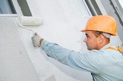 Builder facade painter at work Royalty Free Stock Photography