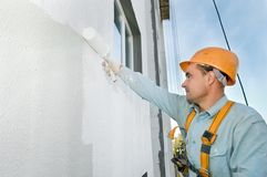 Builder facade painter at work Stock Photos