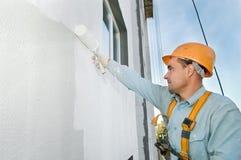Builder facade painter at work Stock Photos