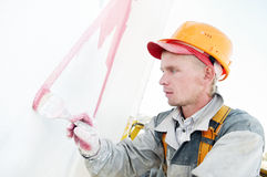 Builder facade painter at work Royalty Free Stock Photo