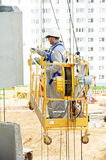 Builder facade painter at work Royalty Free Stock Images