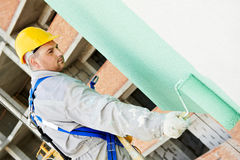 Builder facade painter at work Royalty Free Stock Image