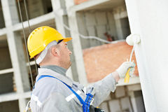 Builder facade painter at work Stock Photography