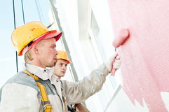 Builder facade painter worker Royalty Free Stock Image