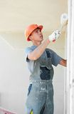 Builder facade plasterer worker Stock Images