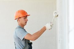 Builder facade plasterer worker Stock Photography