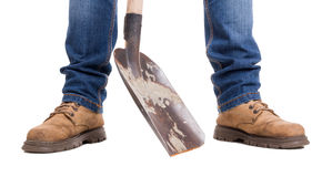 Builder feet and dirty shovel Royalty Free Stock Image