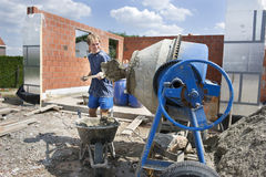 Builder filling a conrete mixer Stock Image