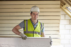 Builder Fitting Insulation Boards To Roof Of New House Royalty Free Stock Images