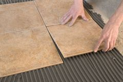 Builder floor tiles installed. Builder floor tiles mounted on a layer of tile adhesive royalty free stock photography