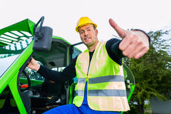 Builder in front of  construction machinery Royalty Free Stock Image