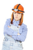 Builder a girl in a helmet royalty free stock image