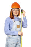 Builder is girl in a helmet and a tape measure stock photos