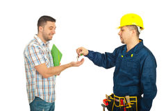 Builder giving keys to client Stock Image