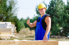 Builder giving a thumbs up gesture Stock Photo