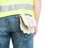 Builder with gloves in pocket wearing safety vest. Builder with gloves in back pocket wearing safety vest isolated on white with advertising area Royalty Free Stock Photos
