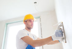 Builder with grinding tool indoors Royalty Free Stock Photo