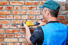 Builder with a hammer Stock Images