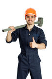 Builder with hammer isolated on white background. Young worker standing with hammer isolated on white background Stock Photo