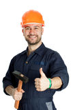 Builder with hammer isolated on white background. Young worker standing with hammer isolated on white background Stock Image