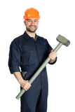 Builder with hammer isolated on white background. Young worker standing with hammer isolated on white background Royalty Free Stock Image