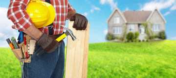 Builder with hammer and wooden planks. Royalty Free Stock Images