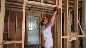 Builder hammering door frame Stock Photo