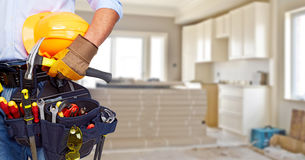 Builder handyman with construction tools. House renovation background stock image