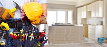Builder handyman with construction tools. House renovation background stock images