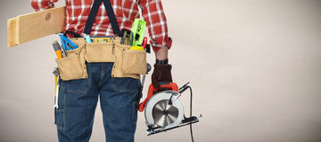 Builder handyman with electric saw. Royalty Free Stock Images