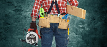 Builder handyman with electric saw. Stock Photo