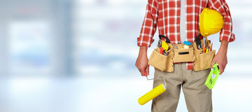 Builder handyman with paint roller. Royalty Free Stock Photography