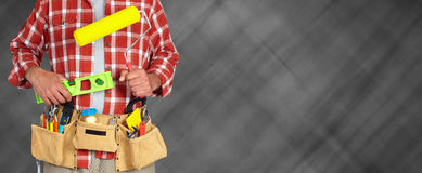 Builder handyman with paint roller. Royalty Free Stock Photos