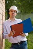 Builder in hard hat with documents Stock Photos