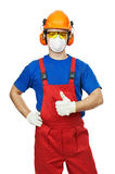 Builder in hardhat, earmuffs, goggles and gas mask Royalty Free Stock Photos