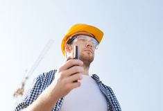 Builder in hardhat with radio Stock Image