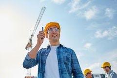 Builder in hardhat with walkie talkie Royalty Free Stock Images